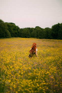 Rebecca Stice GIRL STANDING IN MEADOW OF YELLOW FLOWERS