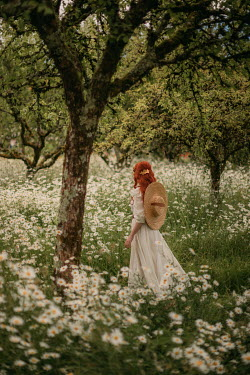 Rebecca Stice GIRL WITH RED HAIR BY TREE WITH DAISIES