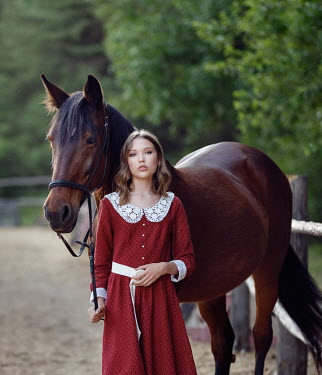 Alexey Kazantsev GIRL STANDING WITH BROWN HORSE OUTDOORS