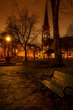 Laurence Winram EMPTY PARK AND HOUSES WITH GOLDEN LAMPLIGHT