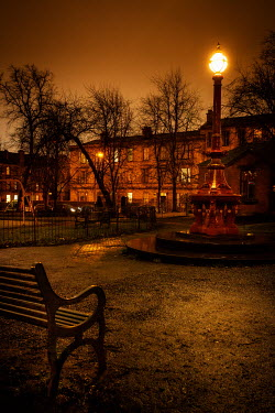 Laurence Winram ORNATE LAMPPOST IN PARK AT NIGHT