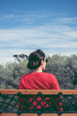 Marie Carr RETRO WOMAN SITTING ON BENCH WITH SUNGLASSES