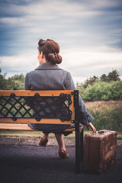 Marie Carr RETRO WOMAN SITTING ON BENCH WITH SUITCASE