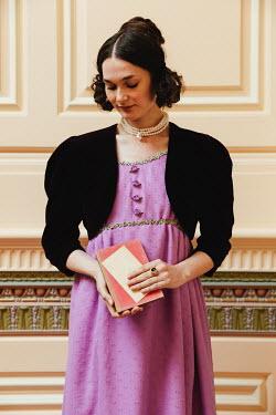 Matilda Delves BRUNETTE REGENCY WOMAN STANDING INDOORS