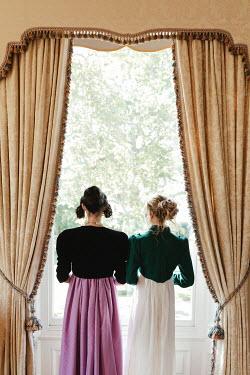 Matilda Delves TWO REGENCY WOMEN SITTING INDOORS WATCHING WINDOW