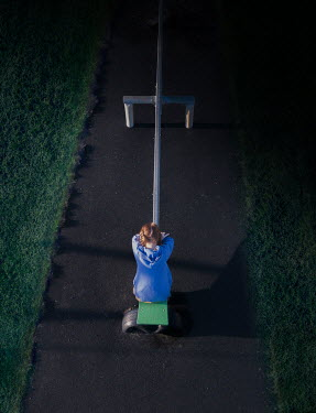 Mary Wethey GIRL ON SEESAW IN PLAYGROUND AT NIGHT