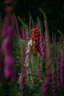 Rebecca Stice WOMAN WITH RED HAIR IN MEADOW OF PINK FLOWERS