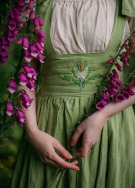 Rebecca Stice WOMAN IN GREEN EMBROIDERED DRESS WITH PINK FLOWERS