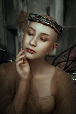 Katerina Klio WOMAN WITH SHAVEN HEAD AND WINGS BY FLOWERS