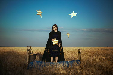 Katerina Klio WOMAN ON BED IN FIELD CATCHING STARS