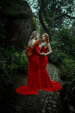 Katerina Klio TWO WOMEN IN RED DRESSES ON GARDEN PATH
