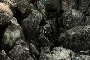 Kirill Sakryukin BAREFOOT GIRL STANDING ON LARGE ROCKS