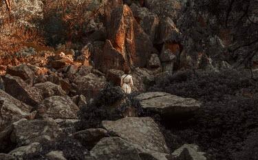 Kirill Sakryukin WOMAN STANDING BY LARGE ROCKS