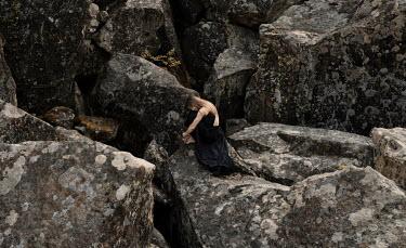 Kirill Sakryukin brunette woman sitting on large rocks