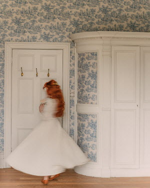 Rebecca Stice WOMAN WITH RED HAIR DANCING IN ROOM