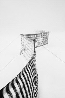Carmen Spitznagel PLASTIC FENCING IN SNOWY FIELD