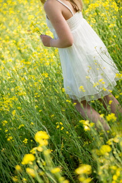 Carmen Spitznagel GIRL WITH WHITE DRESS IN YELLOW MEADOW