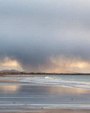 David Baker CLOUDS OVER DESERTED SANDY BEACH