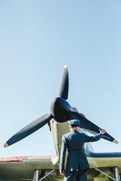 Matilda Delves WARTIME PILOT TOUCHING AEROPLANE PROPELLER