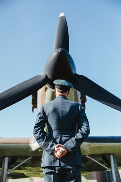Matilda Delves WARTIME PILOT WATCHING AEROPLANE ON GROUND