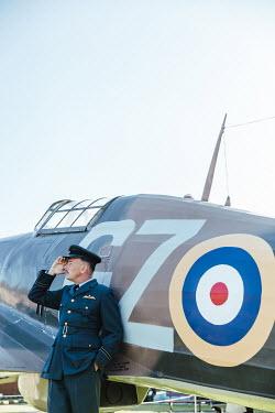 Matilda Delves WATIME PILOT STANDING BY AEROPLANE SALUTING