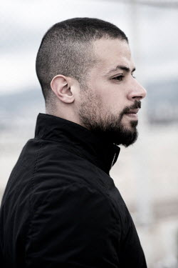 Mohamad Itani MAN WITH SHAVEN HAIR AND BEARD OUTDOORS
