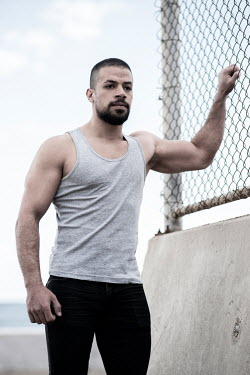 Mohamad Itani MAN STANDING IN PRISON GROUNDS WITH FENCE