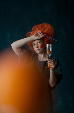 Svitozar Bilorusov WOMAN WITH ORANGE CHEEKS AND HEADDRESS HOLDING GLASS