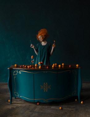 Svitozar Bilorusov WOMAN IN ORANGE HEADDRESS WITH TABLE OF ORANGES