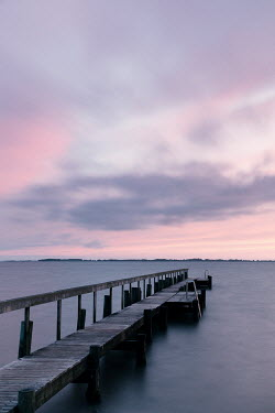 Carmen Spitznagel EMPTY WOODEN JETTY BY WATER AT SUNSET