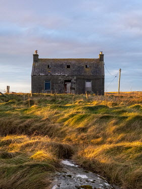 David Baker DERELICT STONE COTTAGE WITH ROCK AND GRASS