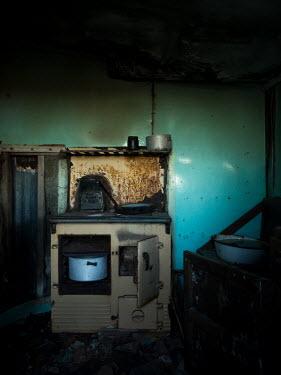 David Baker OLD COOKING RANGE IN ABANDONED HOUSE