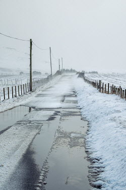 David Baker EMPTY SNOWY COUNTRY ROAD