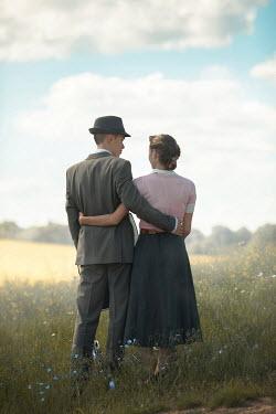 Ildiko Neer Vintage couple with pram in meadow