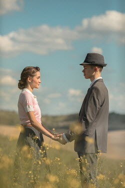 Ildiko Neer Vintage couple standing in meadow