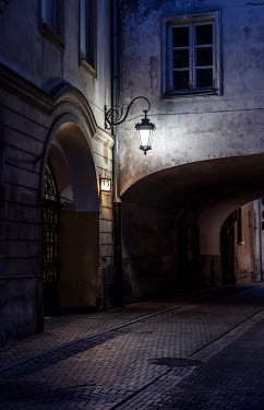 Jaroslaw Blaminsky HISTORICAL STREET WITH BUILDINGS AND ARCHES AT NIGHT