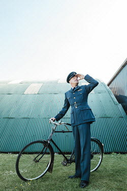 Matilda Delves WARTIME PILOT WITH BICYCLE WATCHING SKY