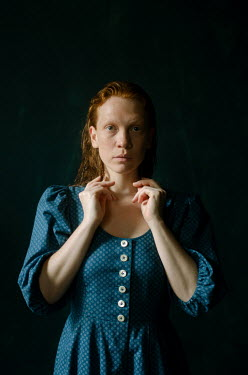 Svitozar Bilorusov SERIOUS WOMAN WITH RED HAIR IN BLUE DRESS