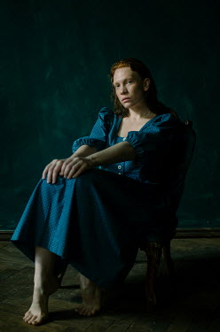 Svitozar Bilorusov BAREFOOT WOMAN WITH RED HAIR SITTING IN SHADOW