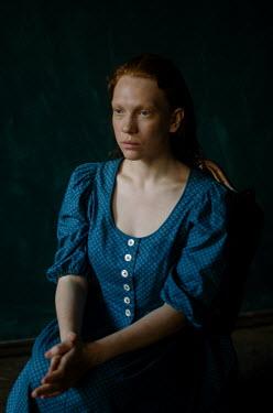 Svitozar Bilorusov WOMAN WITH BLUE DRESS SITTING IN SHADOW