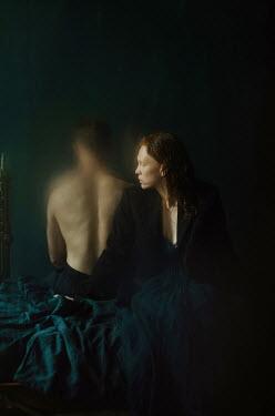 Svitozar Bilorusov UNHAPPY COUPLE SITTING ON BED IN SHADOW
