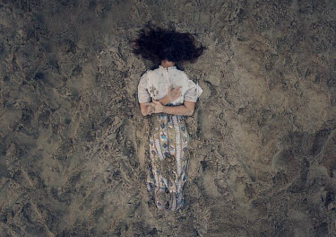 Heather Evans Smith WOMAN LYING FACE DOWN IN SAND