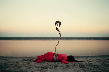 Heather Evans Smith WOMAN LYING ON BEACH TIED WITH ANCHOR