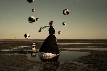 Heather Evans Smith HISTORICAL WOMAN WITH BOUNCING BALLS ON BEACH