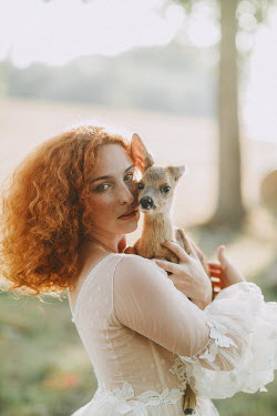 Jovana Rikalo WOMAN IN COUNTRYSIDE HOLDING FAWN