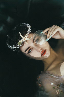 Jovana Rikalo WOMAN LYING IN WATER WITH SHELL