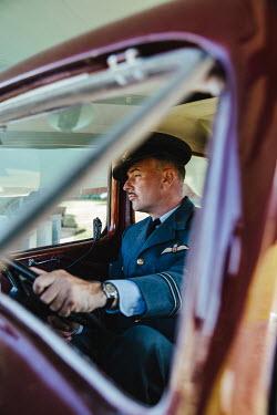 Matilda Delves WARTIME PILOT IN UNIFORM DRIVING CAR