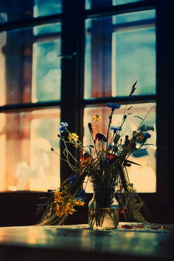 Magdalena Russocka bouquet of wildflowers on table by window of old cottage