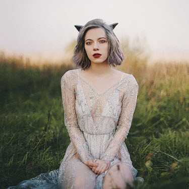 Alexandra Bochkareva WOMAN KNEELING IN GRASS ANIMAL EARS