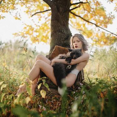 Alexandra Bochkareva GIRL SITTING BY TREE HOLDING FOX